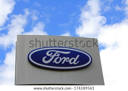 SALO, FINLAND - JUNE 23, 2013: Sign Ford against sky. Ford of Europe reports that its retail sales increased 14 percent for full-year 2013. - stock photo