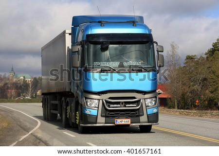 SALO, FINLAND - MARCH 27, 2016: Blue Renault Trucks T Semi on the road with a view to city of Salo in the background.  - stock photo