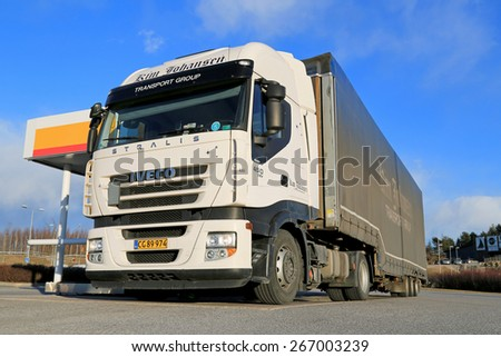 SALO, FINLAND - MARCH 21, 2015: Iveco Stralis 450 Semi truck being refueled. The Iveco Stralis is a heavy-duty truck produced by the Italian manufacturer Iveco since 2002 - stock photo