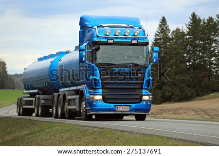 SALO, FINLAND - MAY 1, 2015: Blue Scania R500 tank truck on the road. Scania increased its market share in Europe in Q1 of 2015 to 17,2 percent (15,3 in 2014).  - stock photo