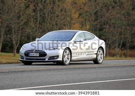 SALO, FINLAND - OCTOBER 31, 2015: Silver Tesla Model S electric car on the road in South of Finland. Tesla will build next generation maps through its autopilot drivers.  - stock photo