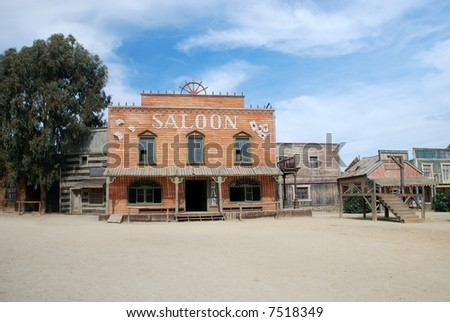 Saloon and gallow in an old American western town - stock photo