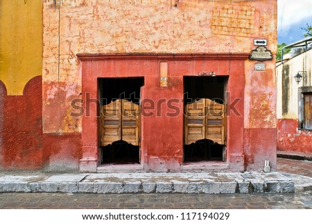 Saloon with swinging doors in Mexico on a colorful cobblestone street - stock photo