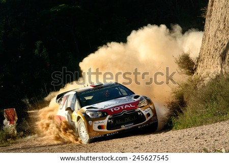 SALOU, SAPIN - OCT 25: Emirati driver Khalid Al Qassimi and his codriver Chris Patterson in a Citroen DS3 WRC race in the 50th Rally RACC Rally of Spain, on Oct 25, 2014 in Salou, Spain. - stock photo