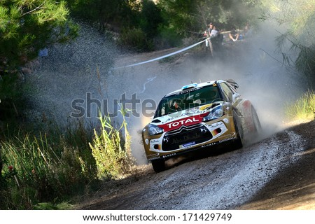 SALOU, SAPIN - OCT 31: Finnish driver Mikko Hirvonen and his codriver Jarmo Lehtinen in a Citroen DS3 WRC race in the 49th Rally RACC Rally of Spain, on Oct 31, 2013 in Salou, Spain. - stock photo