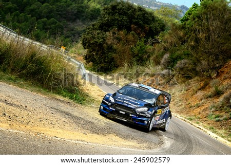 SALOU, SAPIN - OCT 25: Finnish driver Mikko Hirvonen and his codriver Jarmo Lehtinen in a Ford Fiesta RS WRC race in the 50th Rally RACC Rally of Spain, on Oct 25, 2014 in Salou, Spain. - stock photo