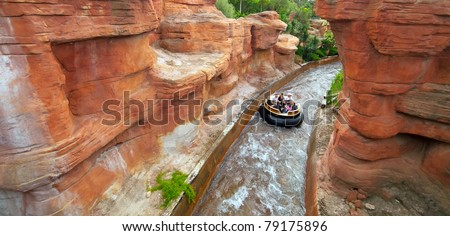 SALOU, SPAIN - APRIL 13: People ride in Theme Park in April 13, 2011 in Salou, Spain. Grand Canyon Rapids  is one of the rides in Old American West area at Port Aventura