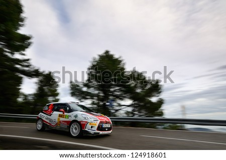 SALOU, SPAIN - NOV 10 : Spanish driver Enrigue Garcia Ojeda and his codriver Pablo Marcos in a Citroen DS3 R3T race in Rally of Spain, on Nov 10, 2012 in Salou, Spain