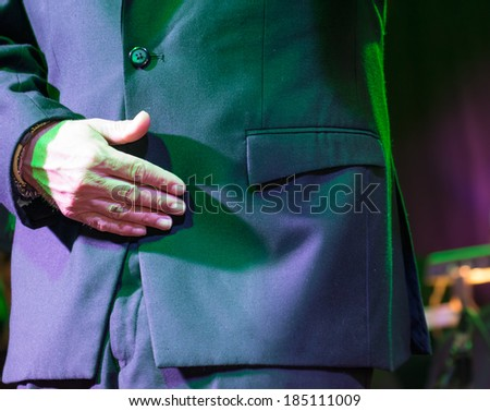 Salsa singer and dancer detail during a live performance. Emotion in the act of dancing - stock photo
