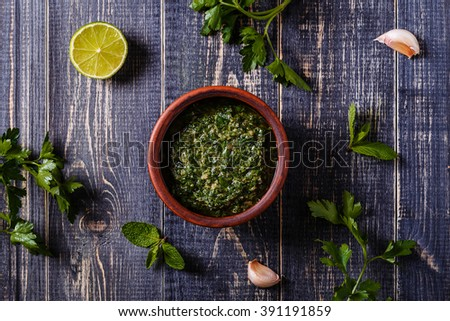 Salsa verde with ingredients, Italian cuisine, top view. - stock photo