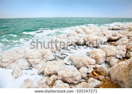Salt accumulation on the Dead Sea shore in Ein Gedi oase. Israel - stock photo