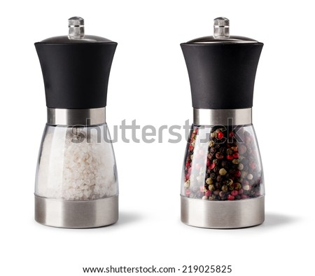 Salt and pepper grinder on white background - stock photo