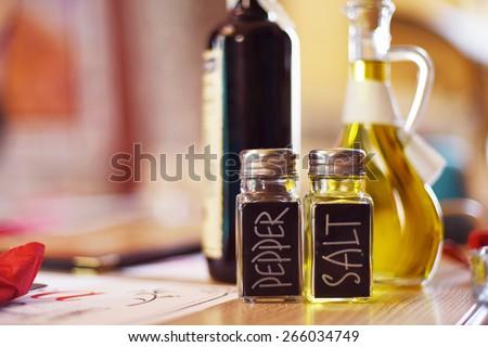 salt and pepper, oil and balsamic vinegar - stock photo