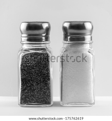 Salt and pepper shakers. - stock photo