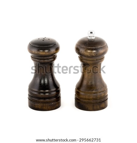 salt and pepper shakers isolated on the white background wooden - stock photo