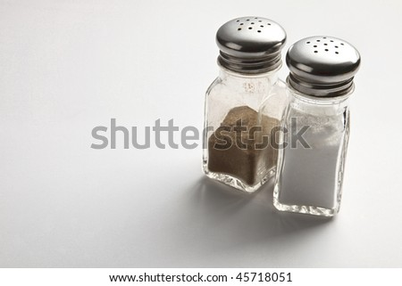 Salt and Pepper Shakers on the plain background - stock photo