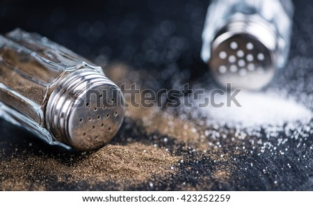 Salt and Pepper Shakers (selective focus; detailed close-up shot) - stock photo