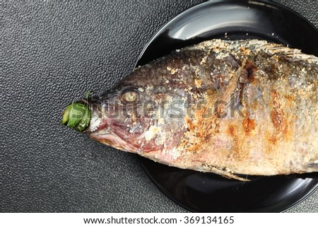Salt baked mango fish represent the thai cuisine and food concept related idea.