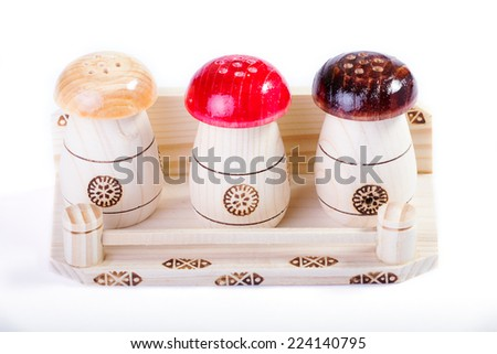 Salt, black pepper, paprika boxes on wooden cutting plate over white background