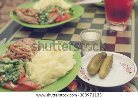 Salt cucumbers, potato, fried meat, salad from fresh cucumbers and tomatoes. Very delicious food on the plate. - stock photo
