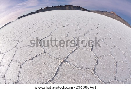 Salt desert Uyuni at sunrise, Bolivia - stock photo