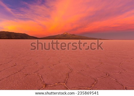 Salt desert Uyuni at sunset, Bolivia - stock photo
