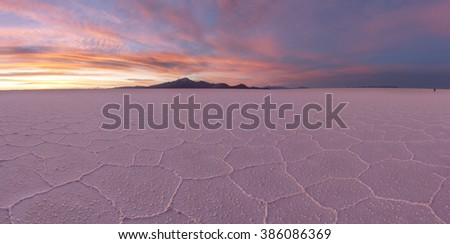 Salt desert Uyuni at sunset panorama, Bolivia - stock photo
