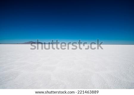 Salt Flats in Utah. Salt Flats Landscape. Dark Blue Sky and Snow White Salt Soil. Boneville near Salt Lake City, Utah, United States. Bonneville Salt Flats - stock photo