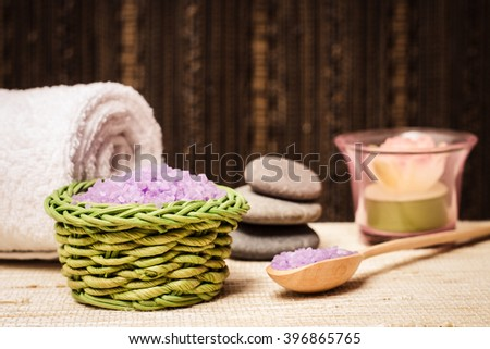 Salt for bath. Spa body hygiene. Natural cosmetic care. Stone, towel, bathroom products. Beauty massage. Organic shower. Wellness relax accessories closeup. - stock photo