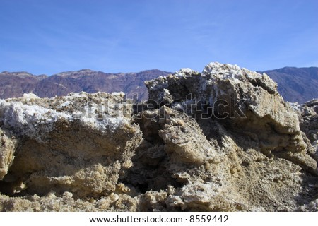 Salt formations with clay mineral deposits in Devil's Golf Course of Death Valley National Park - stock photo