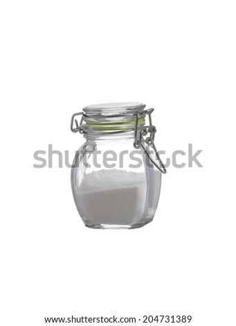 salt in glass bottle on white background - stock photo