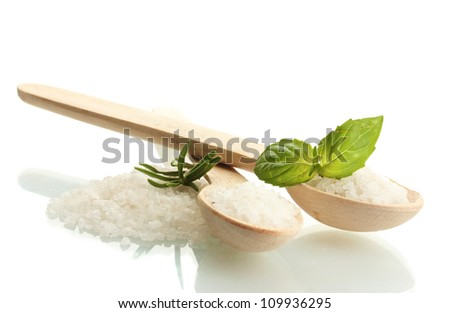 salt in spoons with fresh basil and rosemary isolated on white - stock photo