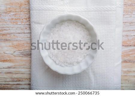 Salt in white pot - stock photo