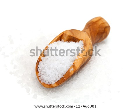salt in wooden scoop isolated on white background - stock photo