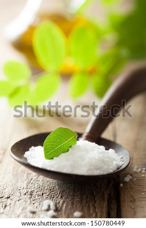salt  in wooden spoon for spa - stock photo