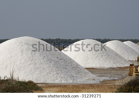 salt is piled up in stacks on a desalination plant in Trapani, Sicily (Italy) - stock photo