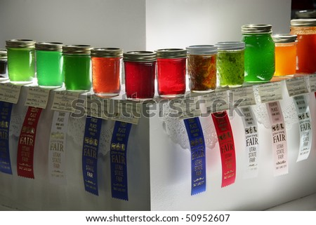 SALT LAKE CITY - SEPTEMBER 10: Homemade jellies on display, with ribbons, at Utah State Fair home canning competition on September 10, 2009 in Salt Lake City, Utah.