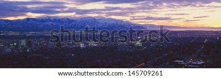 Salt Lake City with snow capped Wasatch Mountains - stock photo