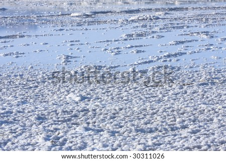 salt mineral coating  above dead sea - stock photo