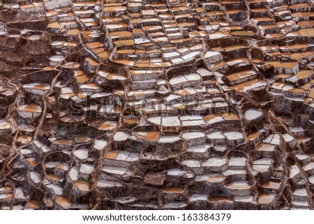 Salt mines at Maras in Sacred Valley of Incas, Peruvian Andes, near Cuzco - stock photo