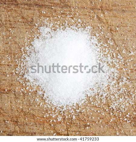 Salt on a wooden surface - stock photo