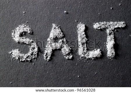 Salt on dark gray background - stock photo