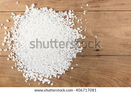 Salt on wood floor table top view
