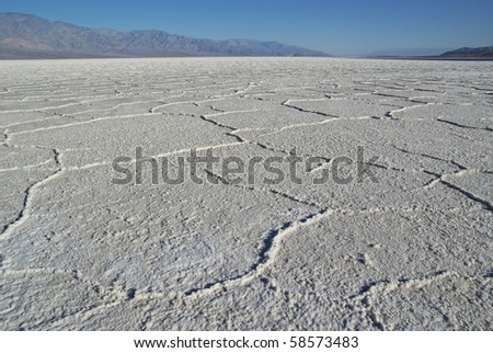 Salt polygons in Death Valley lake in the early morning - stock photo