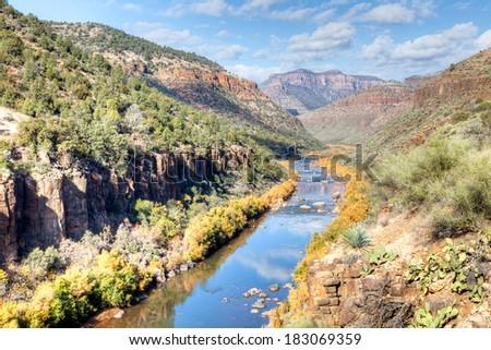 Salt River winding through Apache land. - stock photo