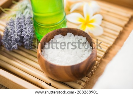 Salt scrub and oil massage on a bamboo mat - stock photo