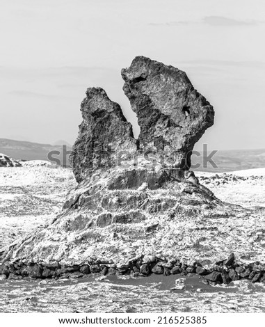 Salt sculptures is beautiful geological formation of Moon Valley in Atacama Desert, Chile (black and white) - stock photo