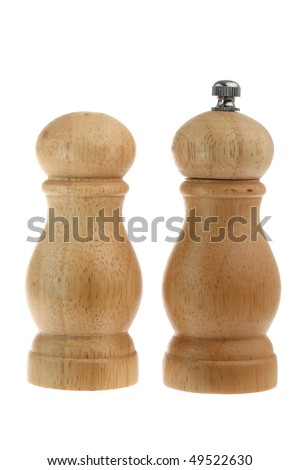 Salt shaker and pepper grinder made from wood isolated on white