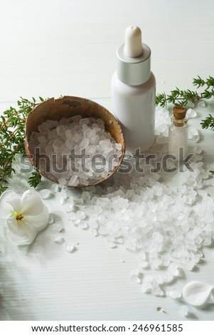 salt with flowers and savory twigs on white wood table