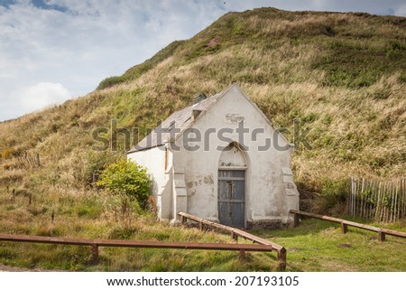 SALTBURN-BY-THE-SEA, UNITED KINGDOM - 18 JULY, 2014: 19th century seaside mortuary in Saltburn, English Heritage grade II listed building, used to store bodies of victims of drowning in the North Sea - stock photo